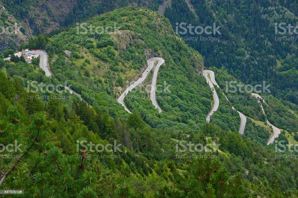 Alpe d'Huez - Curves and church stock photo