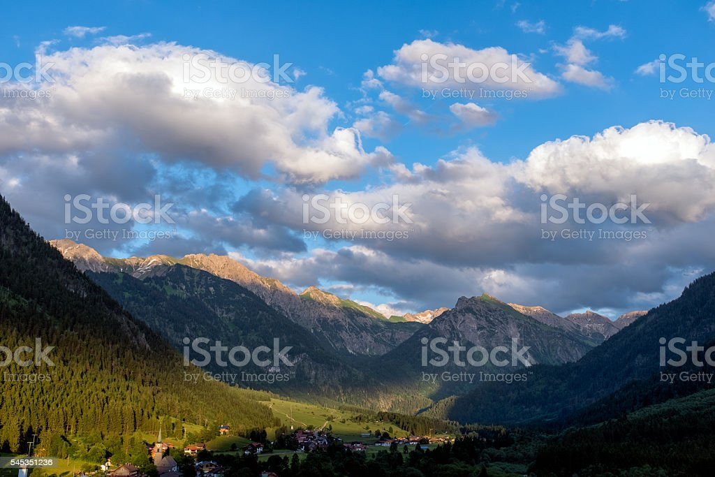 Alpen glow across a mountain range in bavaria stock photo