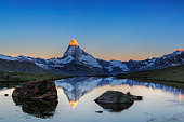 Alpen glow at Matterhorn with Stellisee in foreground