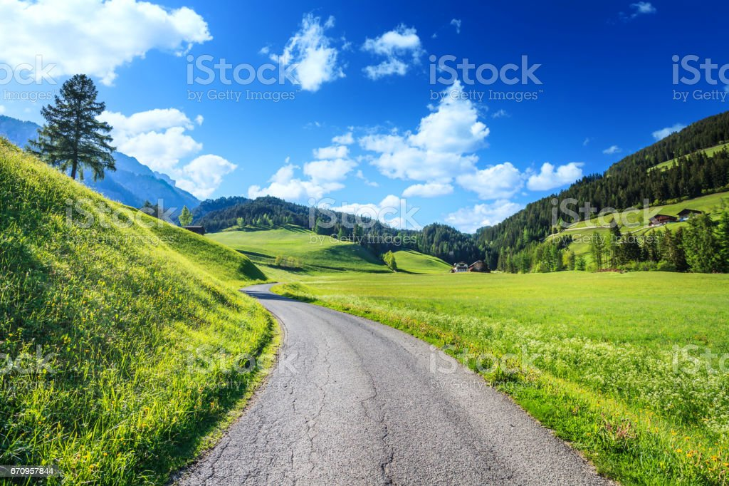 Alpen Landscape - Rolling Hills, Meadows, and Country Road stock photo