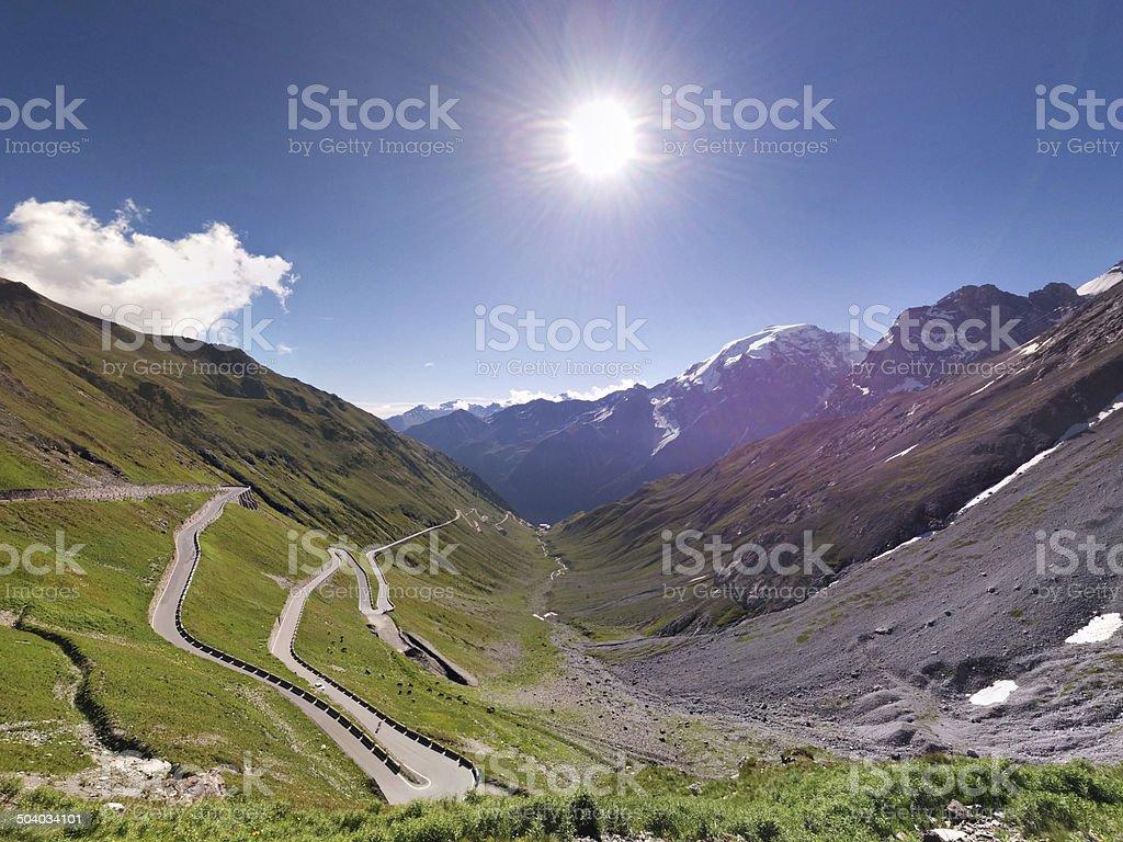 Alpen Roads, Stelvio pass with sun stock photo