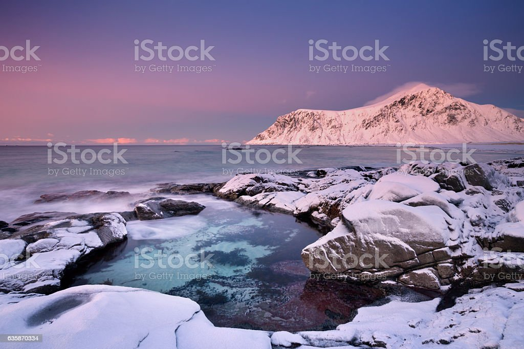 Alpenglow at Skagsanden beach on the Lofoten, Norway stock photo