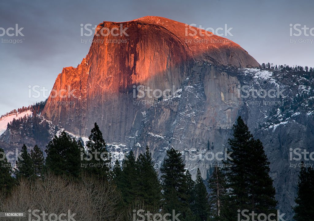 Alpenglow effect on Half Dome in Yosemite National Park stock photo