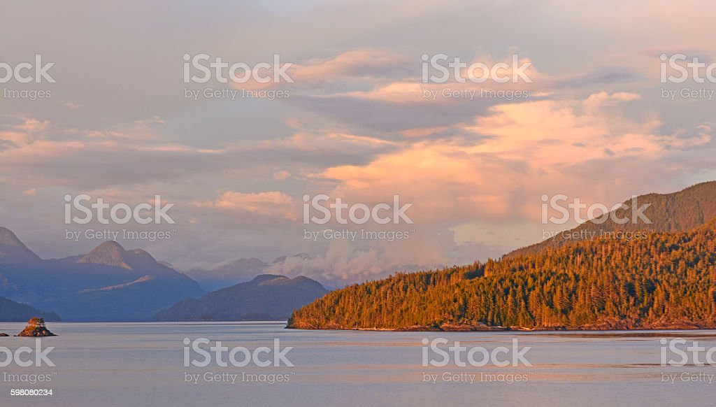 Alpenglow on a Coastal Shore stock photo