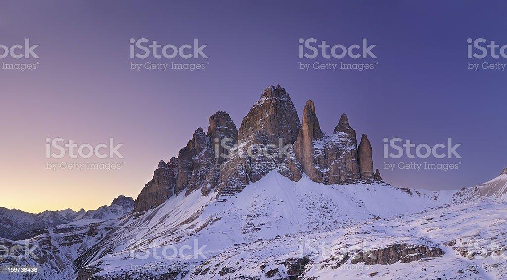 Alpenglow on the Tre Cime Di Lavaredo (Dolomites - Italy) stock photo