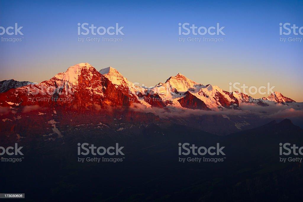 Alpengluehen Eiger mountains at sunset stock photo