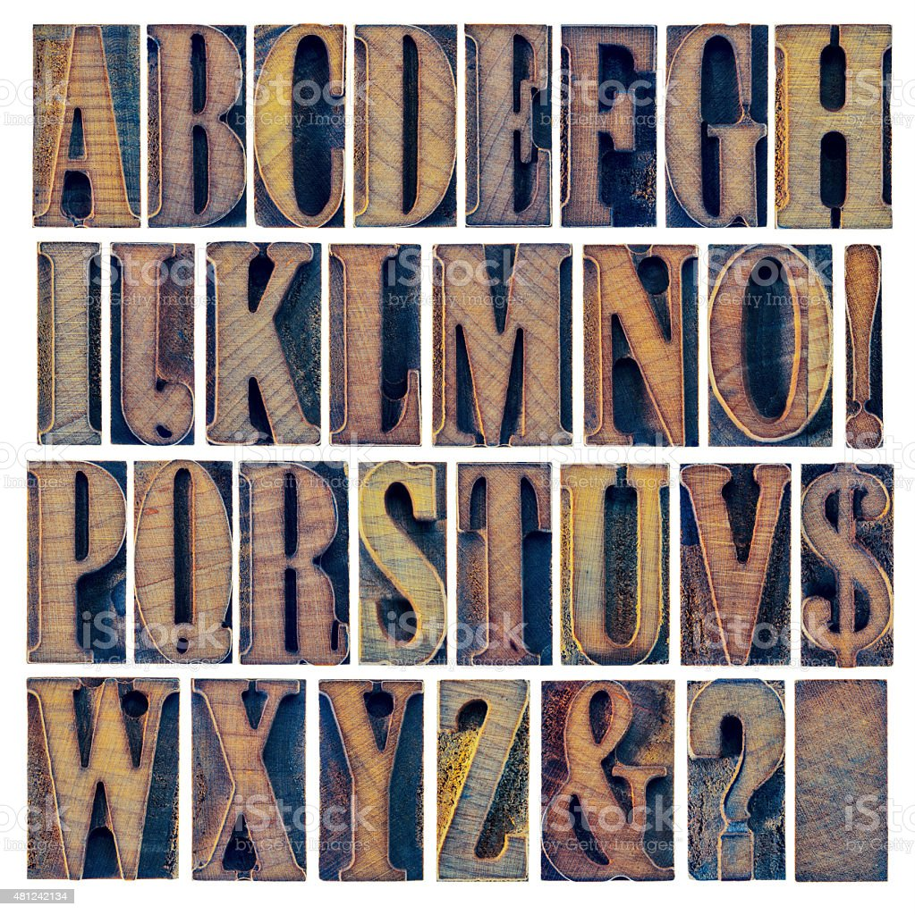 alphabet and punctuation in wood type stock photo