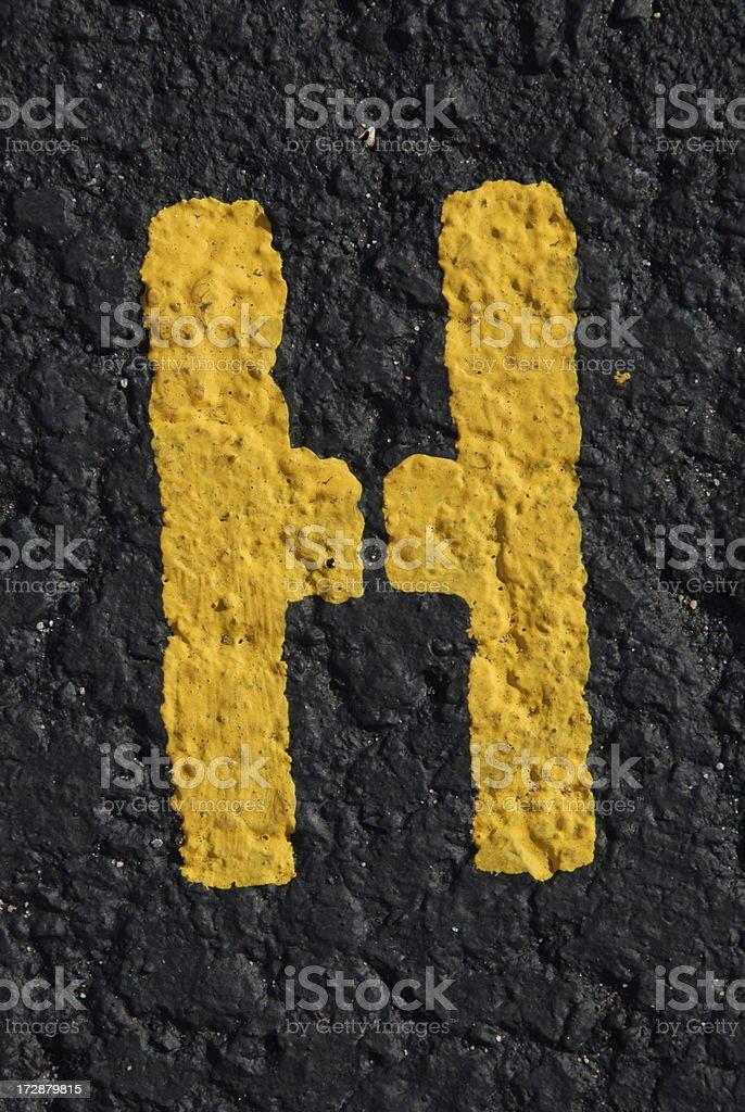 Alphabet, Asphalt Stenciled H royalty-free stock photo