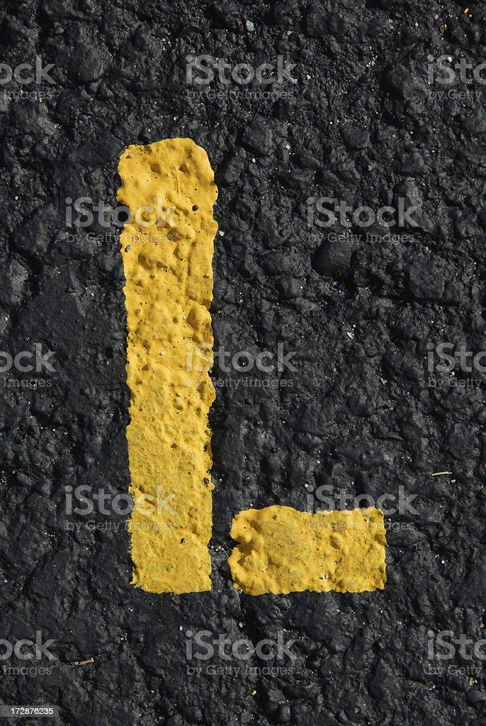 Alphabet, Asphalt Stenciled L royalty-free stock photo
