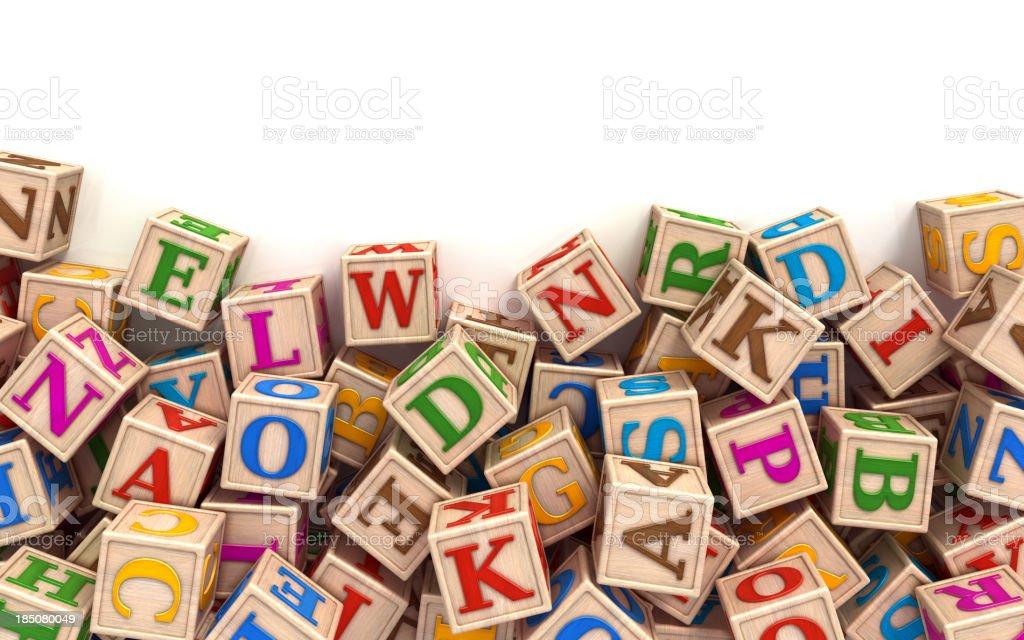 Alphabet blocks scattered at the bottom stock photo