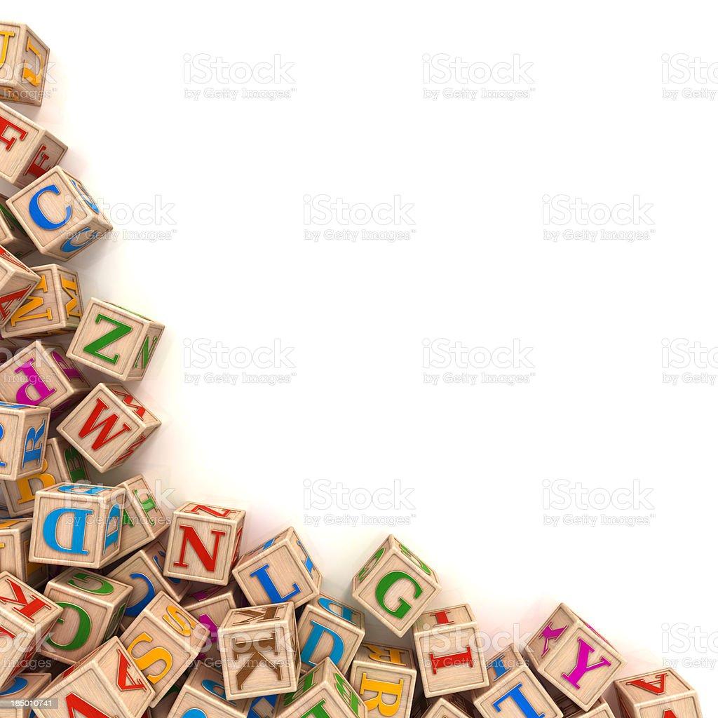 Alphabet blocks scattered in the corner stock photo