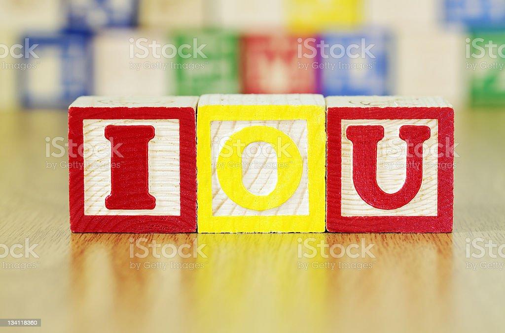 Alphabet Blocks Spelling out IOU stock photo