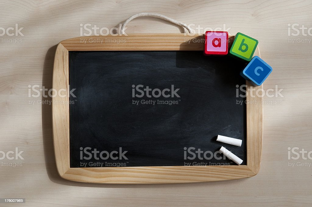 Alphabet blocks with chalkboard royalty-free stock photo