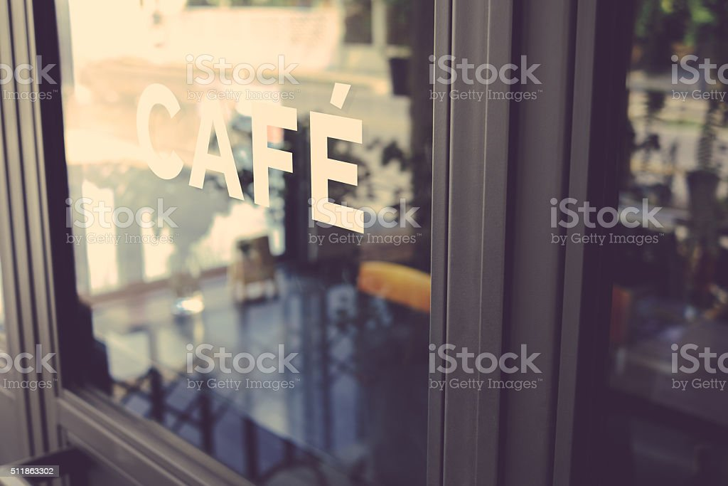 Alphabet cafe word on the window vintage color stock photo