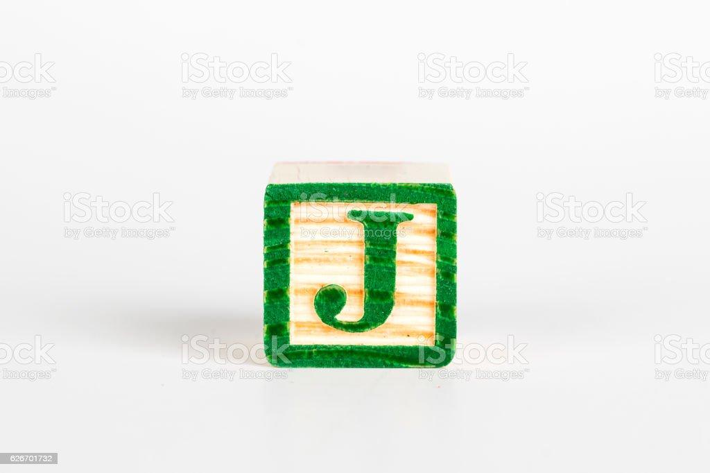 LETTER J alphabet cubes font stock photo