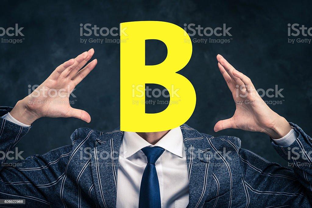 Alphabet face businessmen stock photo