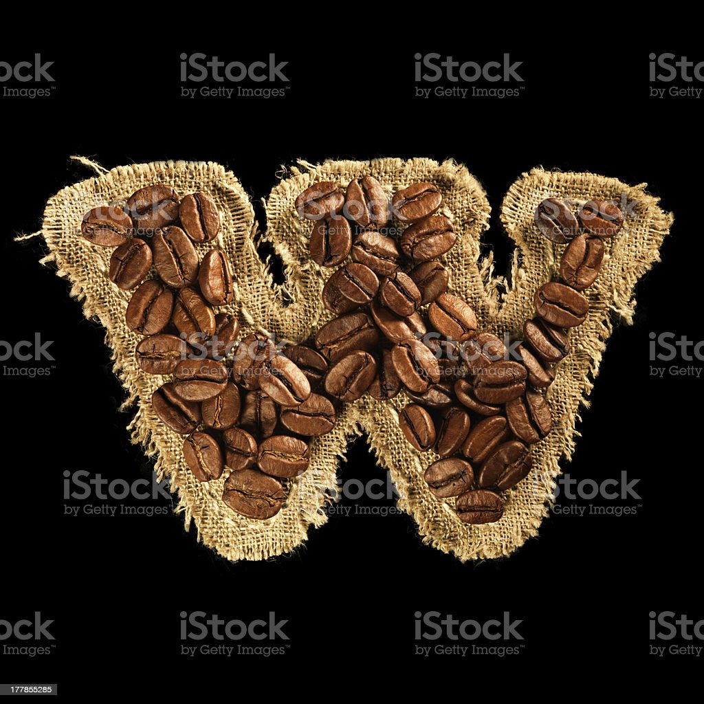 Alphabet from coffee beans on fabric texture isolated black royalty-free stock photo