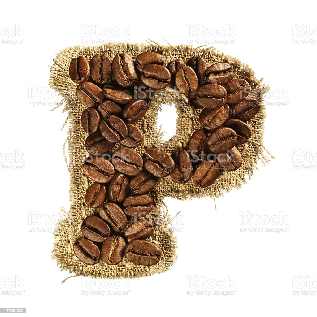 Alphabet from coffee beans on fabric texture royalty-free stock photo