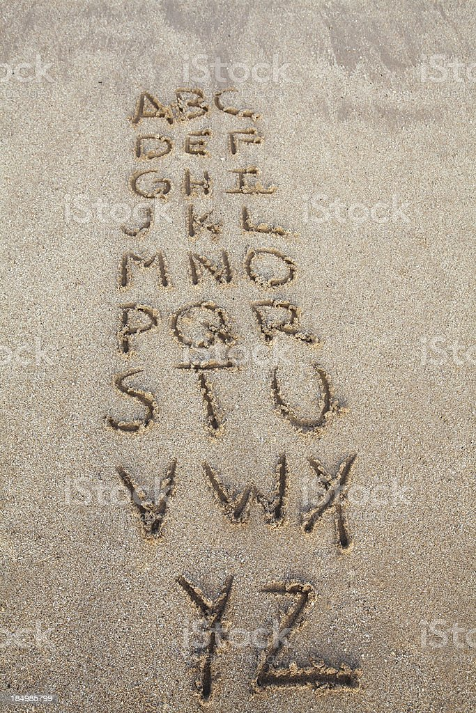 Alphabet in the sand royalty-free stock photo