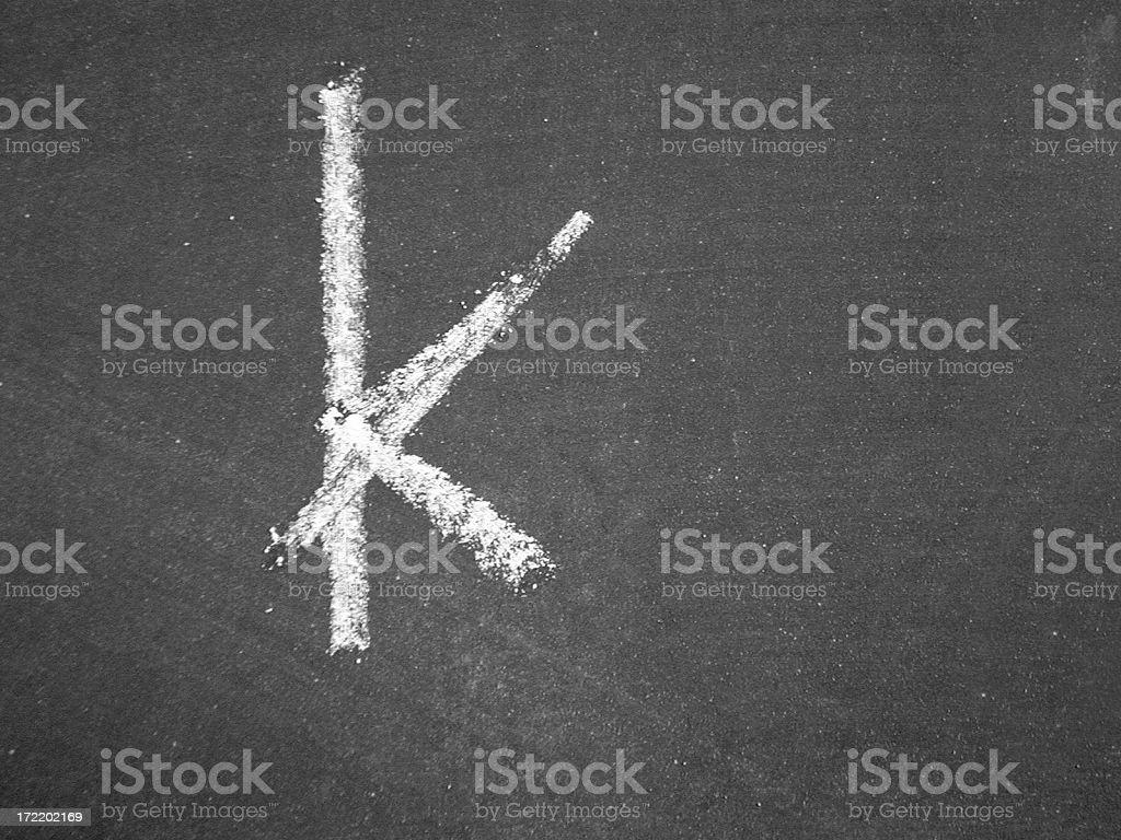 Alphabet - k - Chalk stock photo
