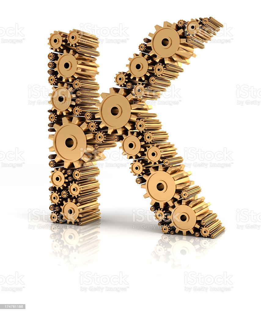 Alphabet K formed by gears stock photo