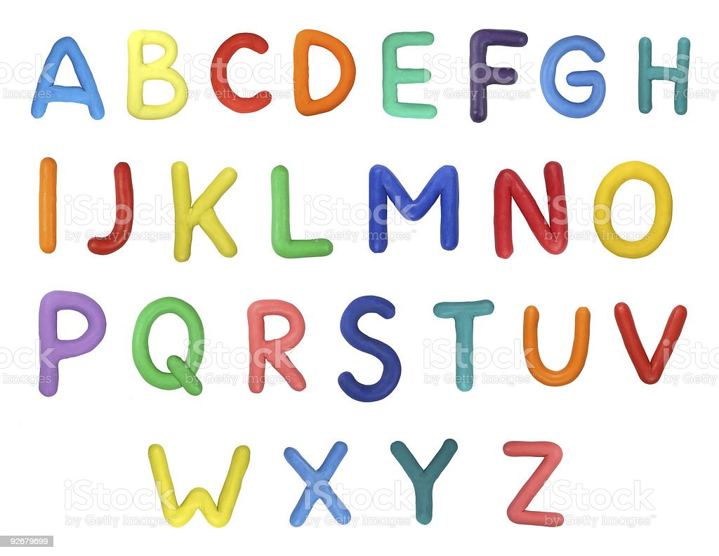 Alphabet letters in different colors on a white background stock photo