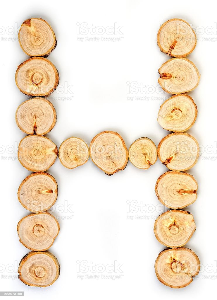 Alphabet letters made from Wood slice on white Background.H. stock photo