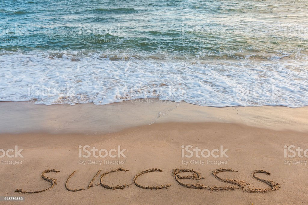 alphabet letters success handwritten in sand on beach stock photo