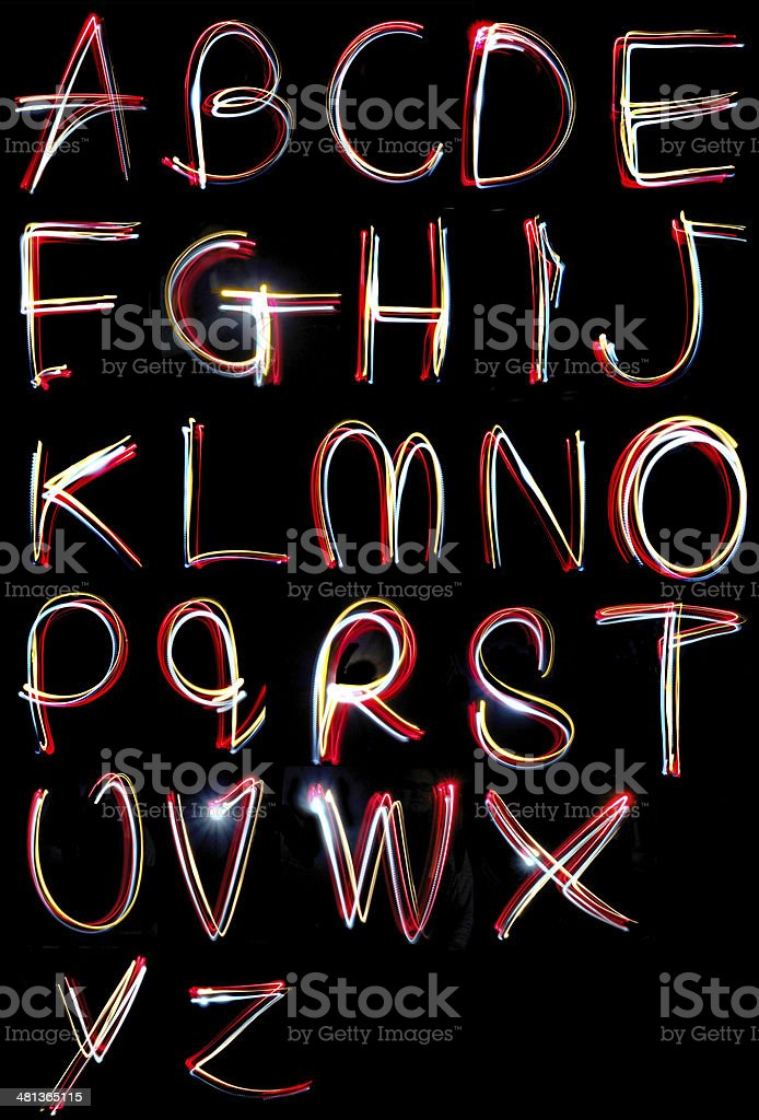 alphabet light neon writing long exposure stock photo