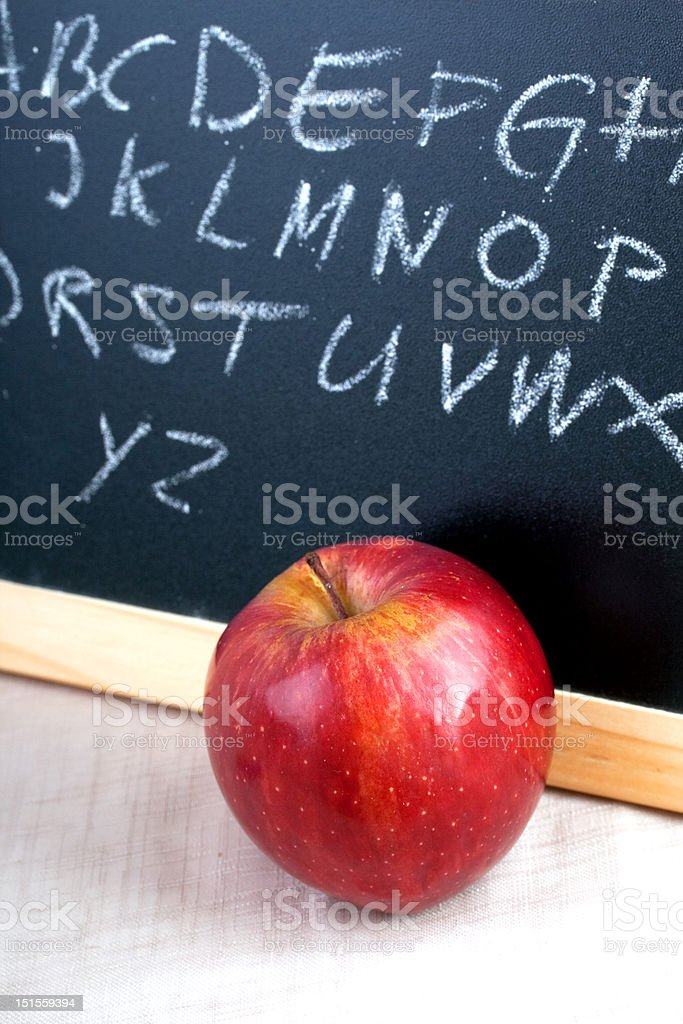 Alphabet scribbles on blackboard with lunch apple royalty-free stock photo