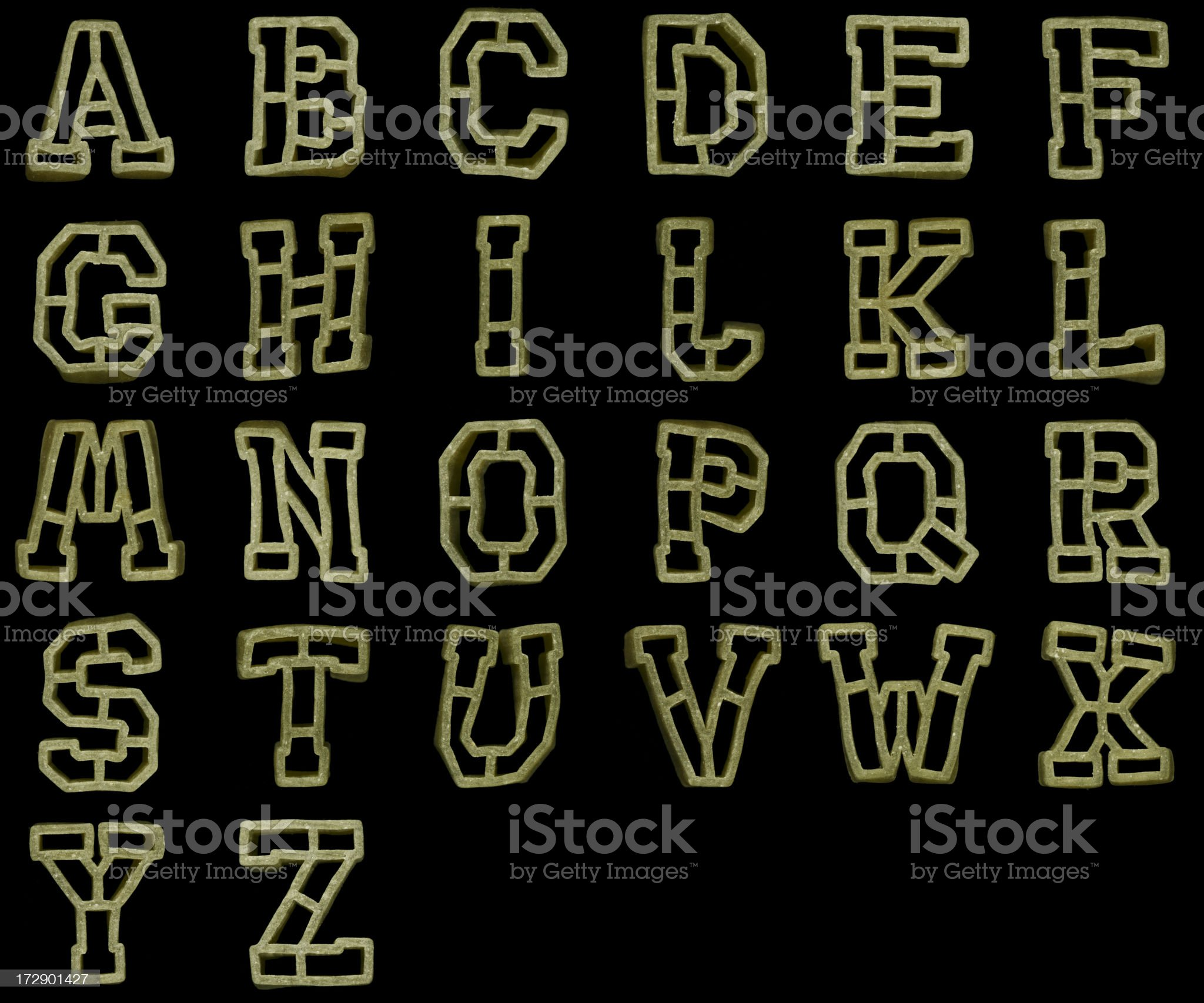 Alphabet spinach pasta uncooked on black (XXL+) royalty-free stock photo
