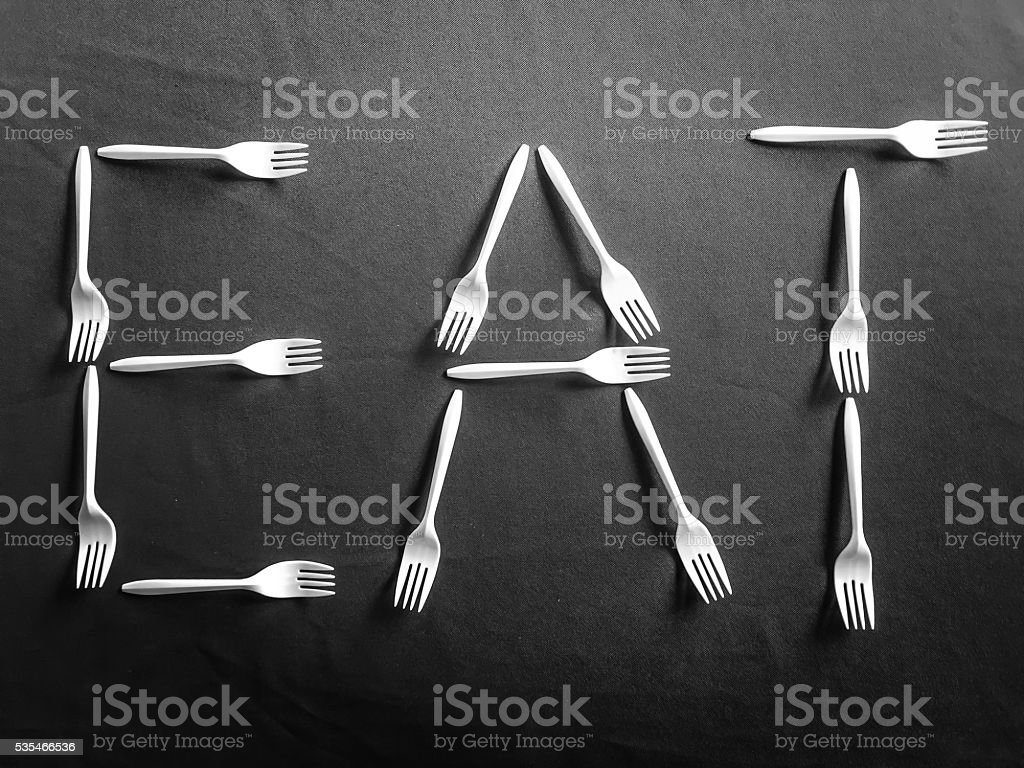 EAT alphabet with plastic forks in black and white stock photo