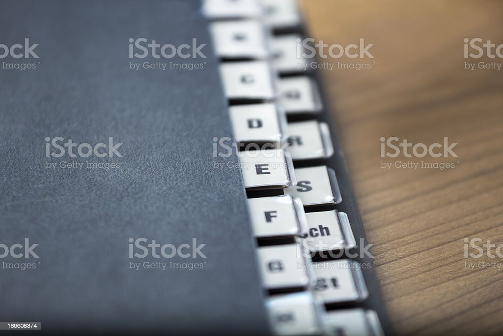 Alphabetical registry on a black folder stock photo