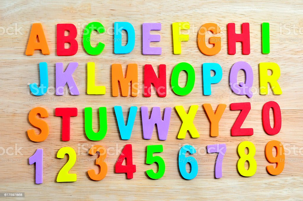 ABC alphabets on wooden background stock photo