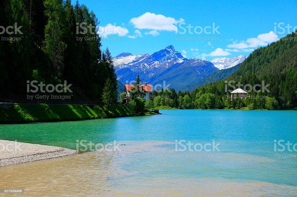 Alpine Alleghe blue Lake: idyllic Dolomites landscape, Italian Tirol alps stock photo
