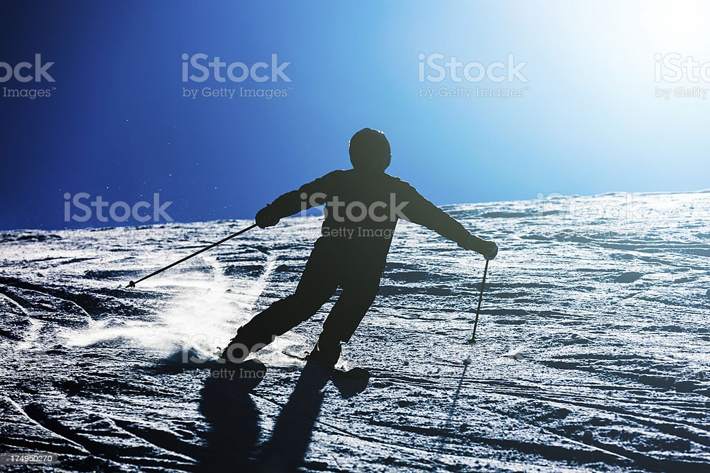 Alpine carving skiing on sunny day stock photo