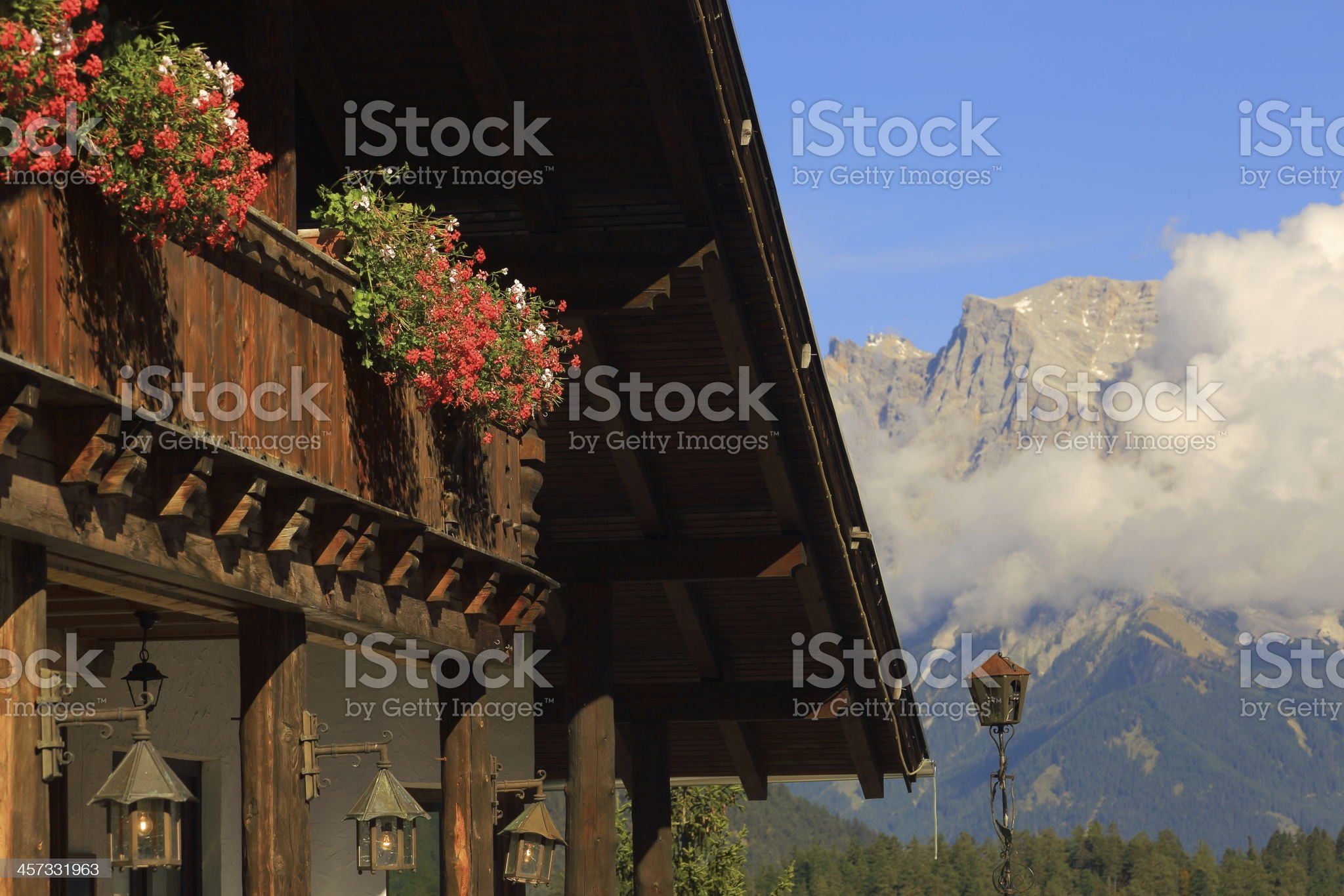 Alpine Chalet facing Zugspitze mountain royalty-free stock photo