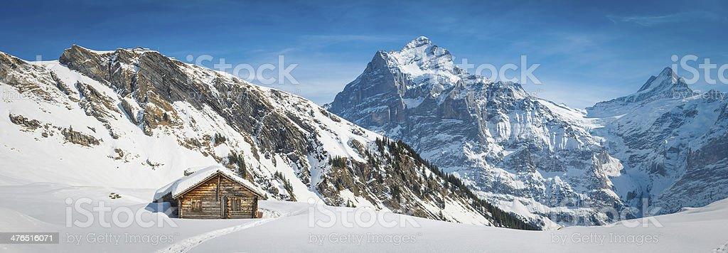 Alpine chalet in idyllic snowy winter mountain panorama Alps Switzerland stock photo