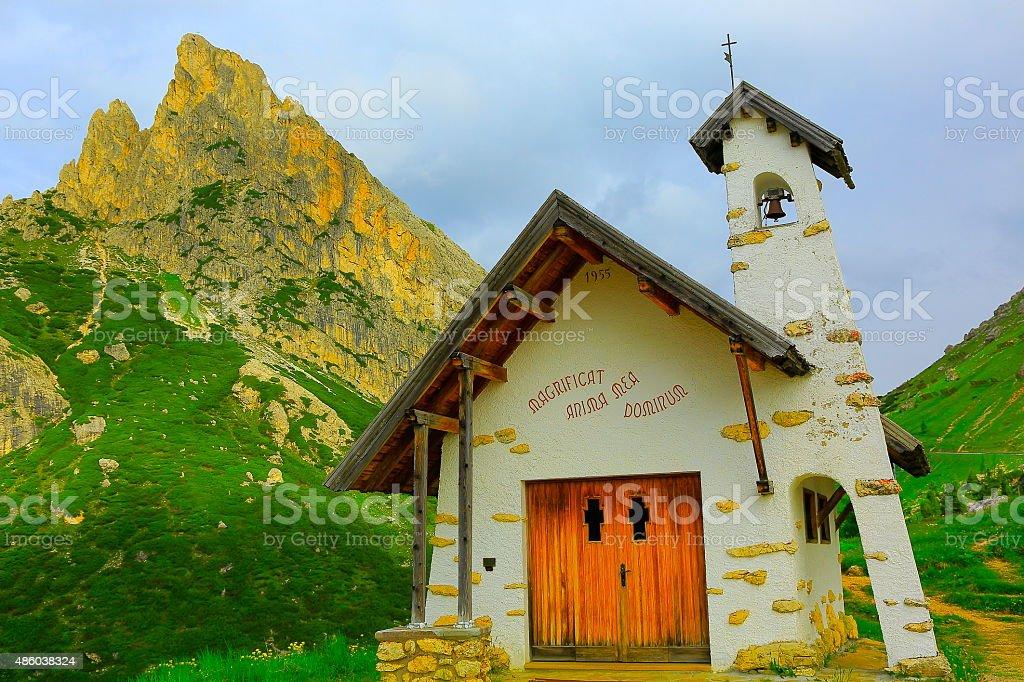 Alpine Church Chapel in Falzarego, Dolomites, Italian Tirol Alps stock photo