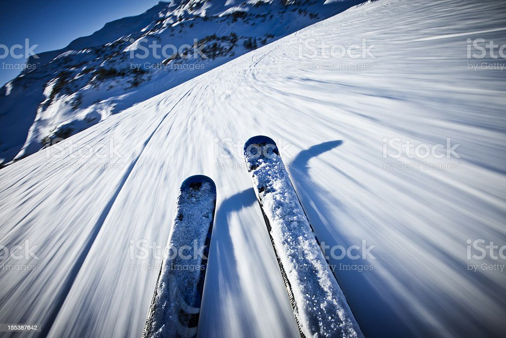 Alpine downhill skiing on sunny day royalty-free stock photo