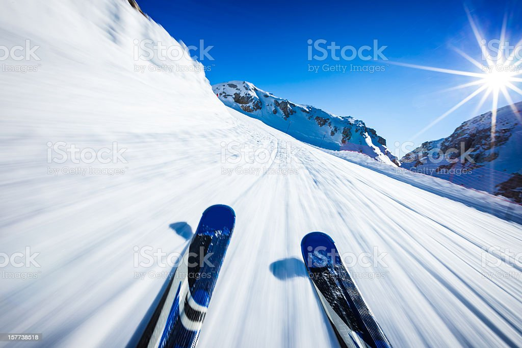 Alpine downhill skiing on sunny day stock photo