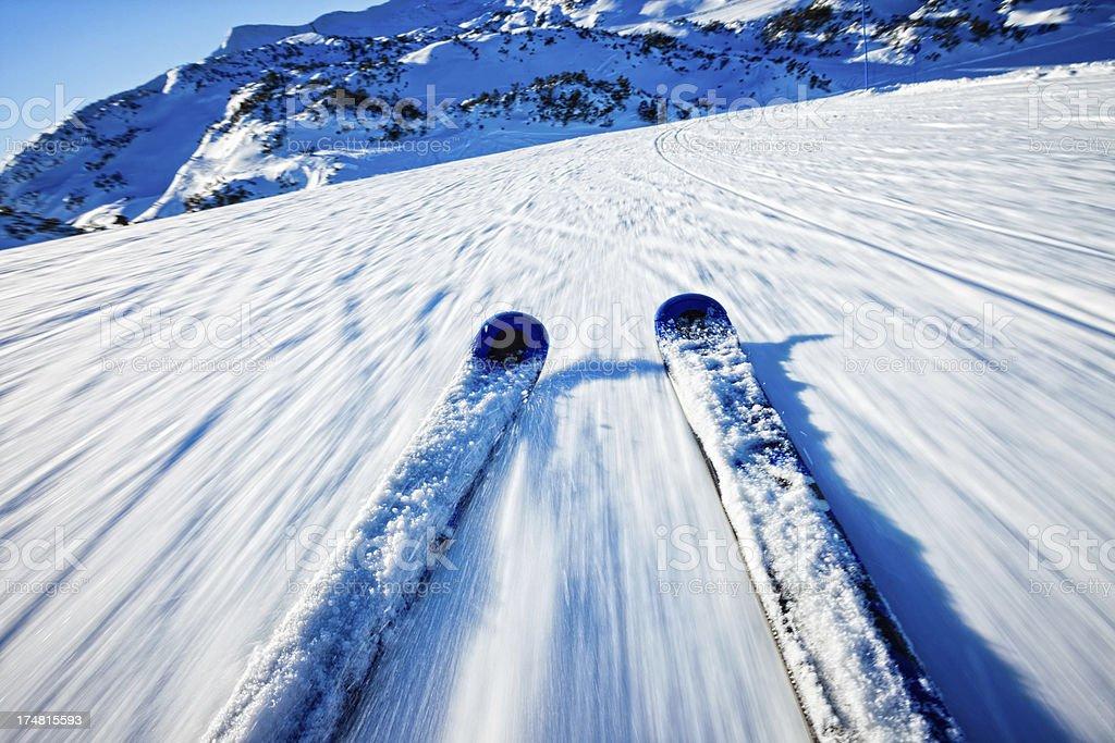 Alpine downhill skiing on sunny day stock photo