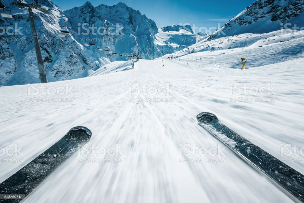 POV of alpine downhill skiing stock photo