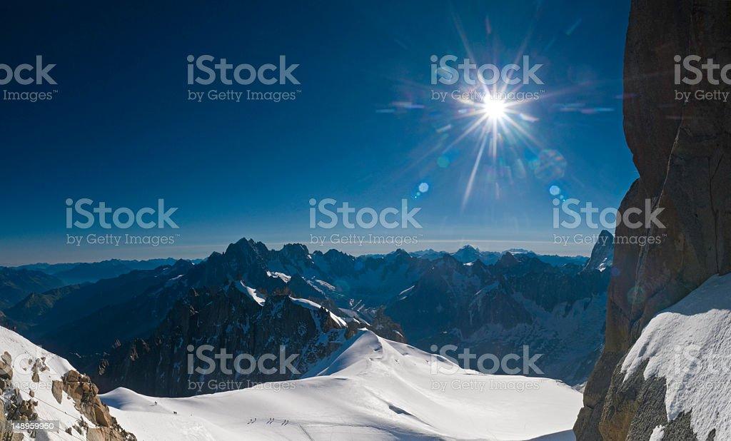 Alpine high summit sunburst stock photo