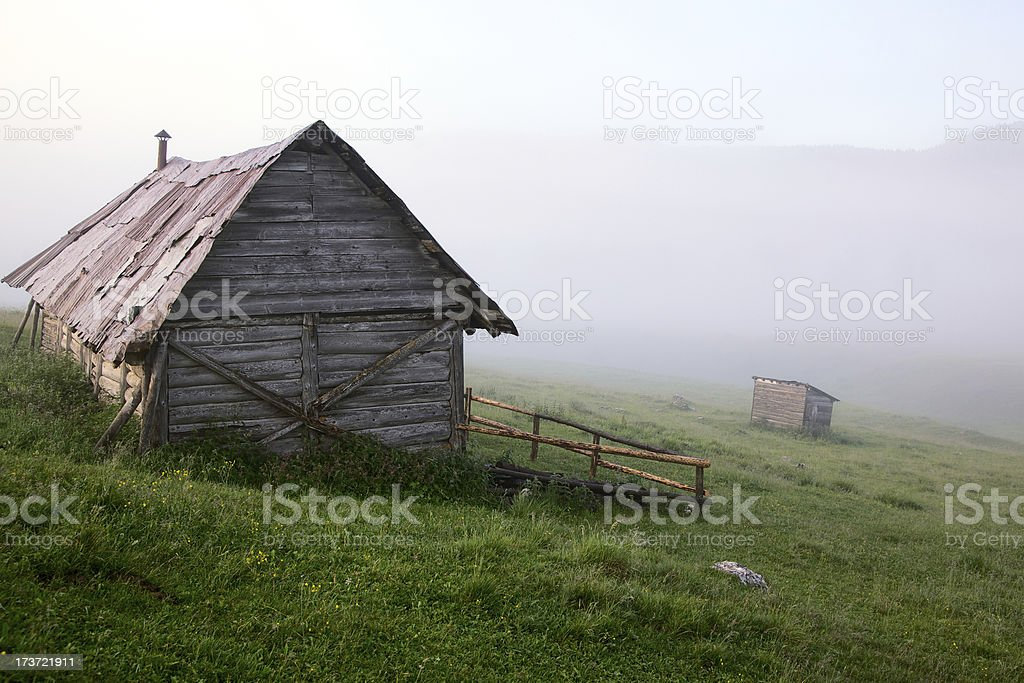 Alpine hut in a misty weather royalty-free stock photo