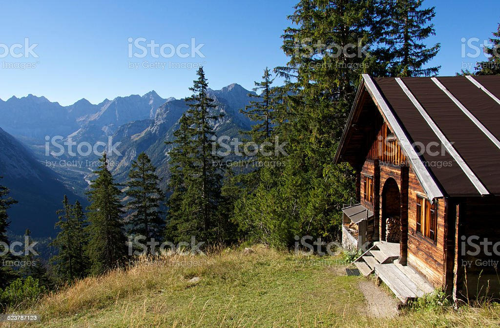 Alpine hut in the mountains stock photo