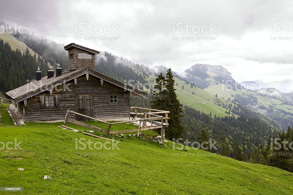 Alpine hut on a cloudy day stock photo