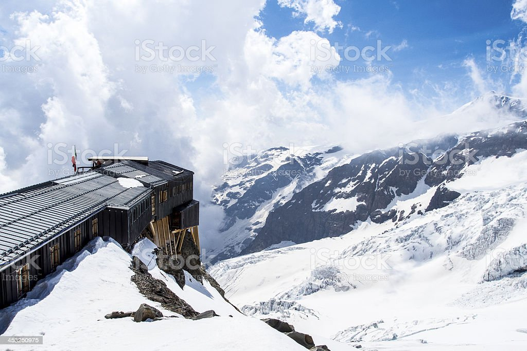 Alpine hut stock photo