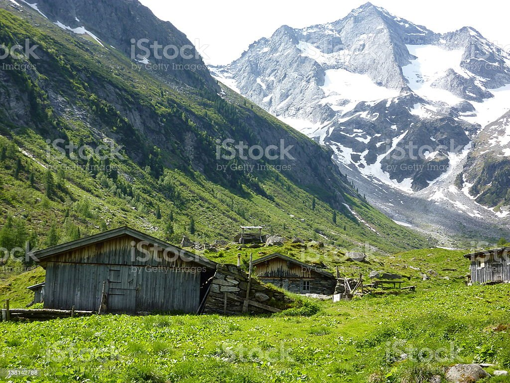 Alpine huts with glacier in the background stock photo