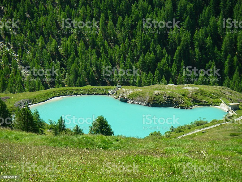 Alpine lake filled with turquoise-colored glacial melt above Zermatt Switzerland stock photo